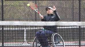 Harborfields' Nate Melnyk hits a forehand during a