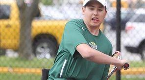 Harborfields High School tennis player Nate Melnyk playing