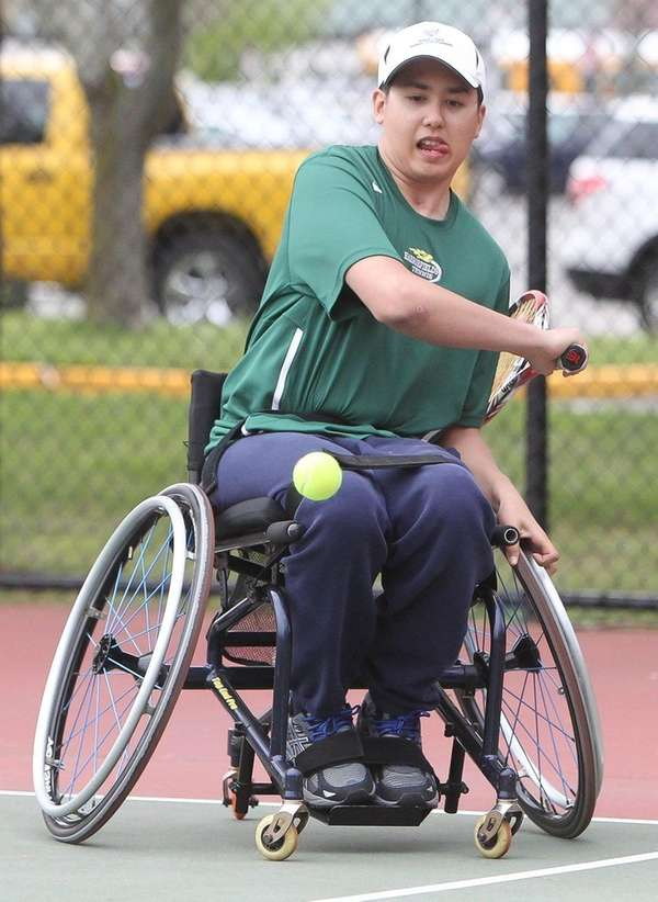 Harborfields High School tennis player Nate Melnyk playing