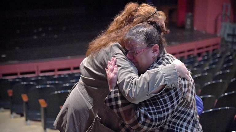 Jeanne D'Esposito, right, is comforted by Laura Young