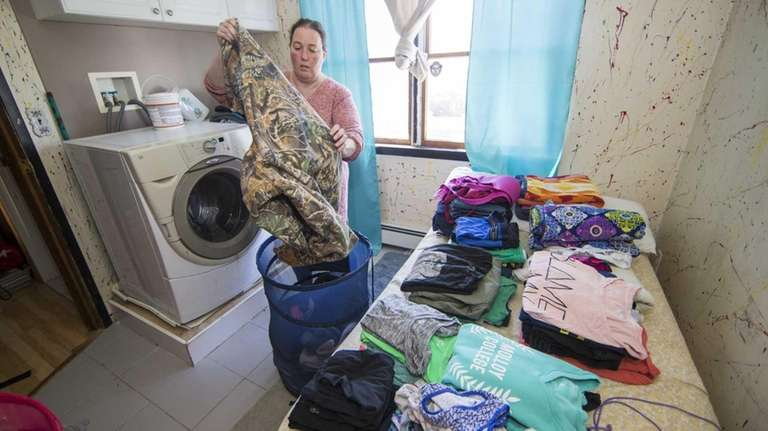 Richelle Nelson does the family laundry on Sunday,