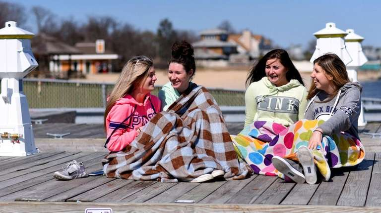 Teens from Selden take in the sun and