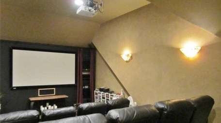 This Riverhead home has an 11-seat, tiered movie