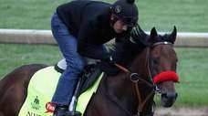 Exercise rider Jonny Garcia takes Nyquist over