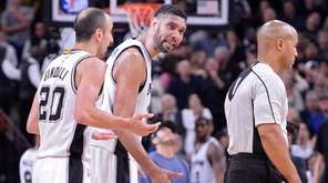 San Antonio Spurs' Tim Duncan, second from