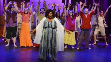 Taneisha Corbin, center, as Noah's wife, with the