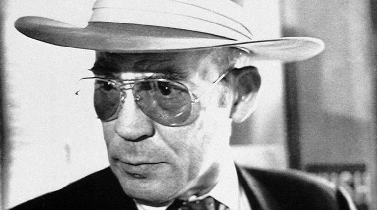 Author Hunter S. Thompson talks to reporters