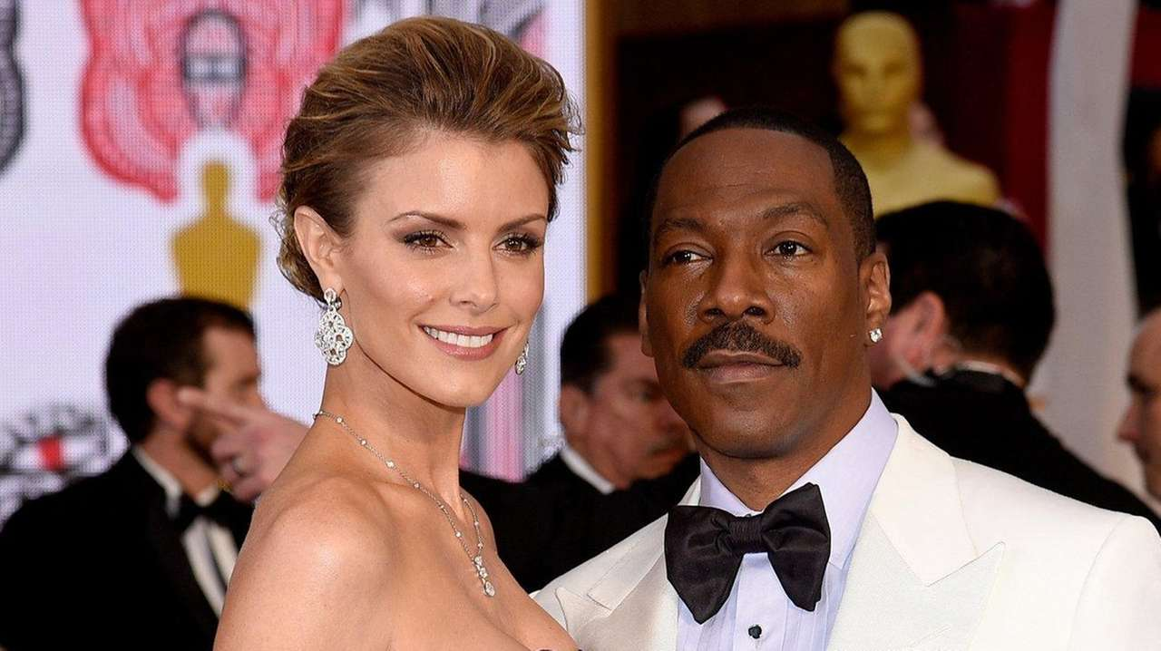 Eddie Murphy and model Paige Butcher at the
