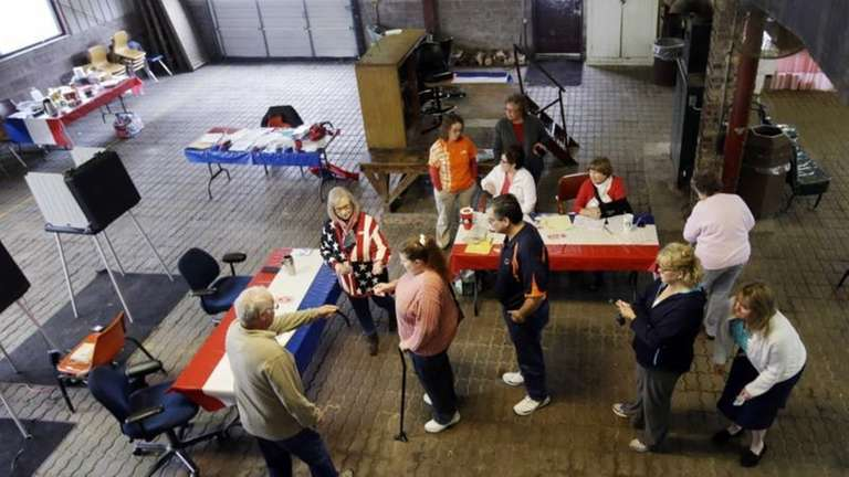 Voters wait to cast their ballot in the
