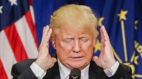 Republican presidential candidate Donald Trump gestures as he