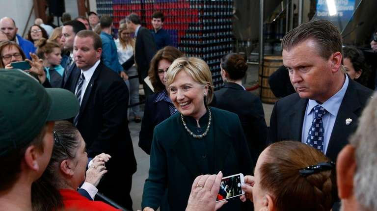 Democratic presidential candidate Hillary Clinton greets supporters at