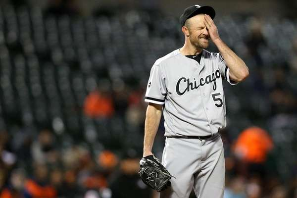 Chicago White Sox starting pitcher John Danks wipes