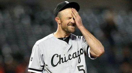 Chicago White Sox starting pitcher John Danks wipes