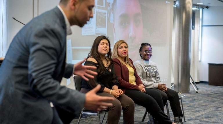 Immigration reform advocate Hendel Leiva speaks with guests