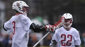 Mac O'Keefe #3 of Syosset, left, reacts after