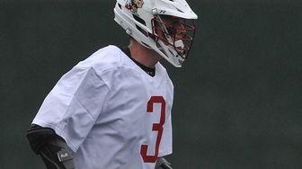 Mac O'Keefe #3 of Syosset surveys the defense