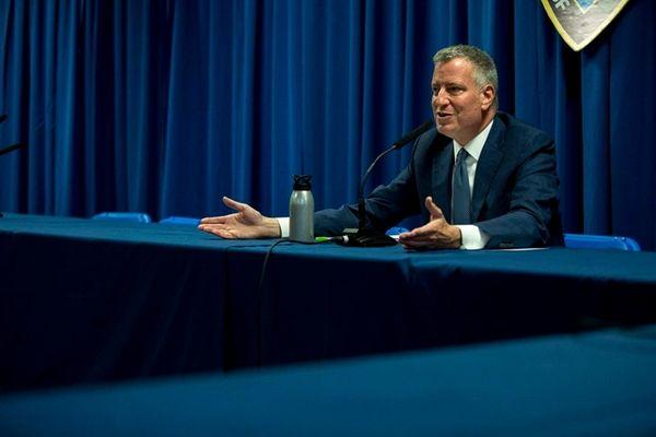 Mayor Bill de Blasio talks to reporters at