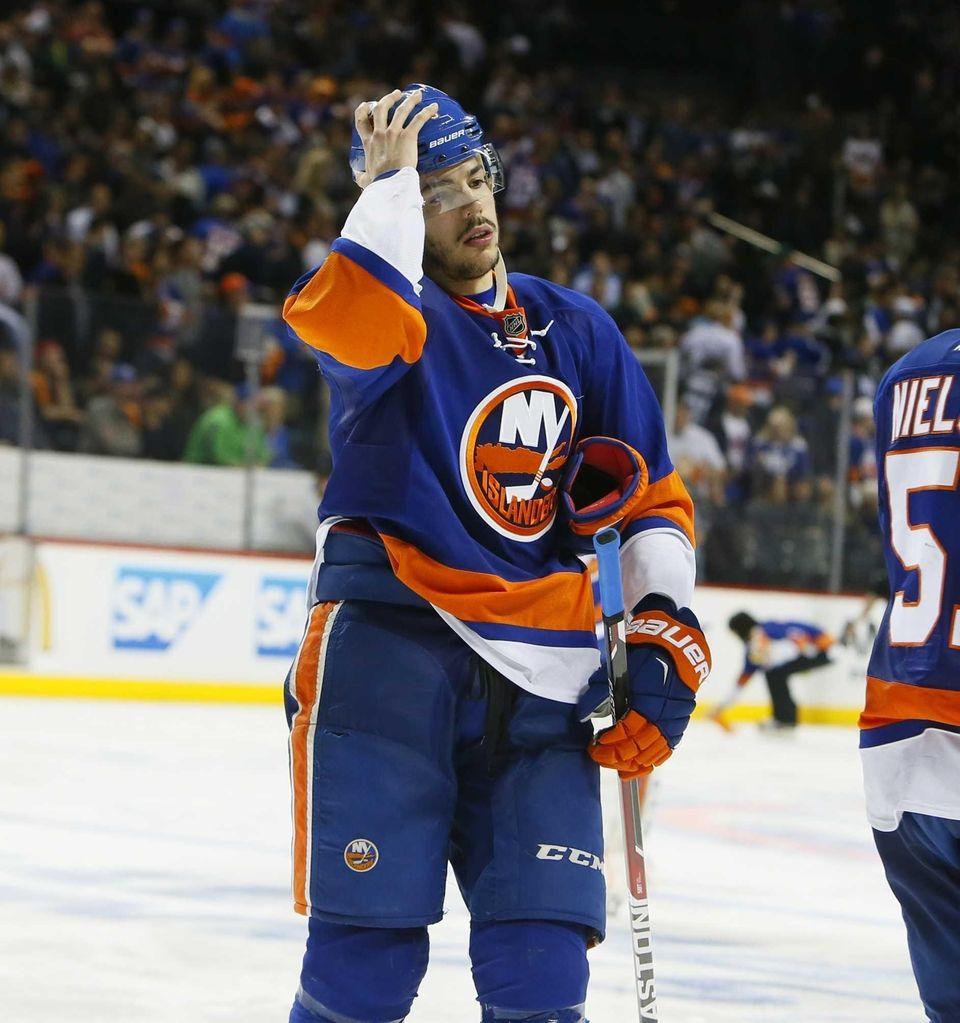 New York Islanders defenseman Travis Hamonic (3) walks