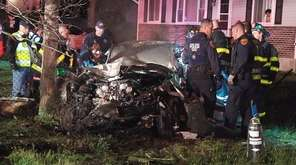 Suffolk County police investigate a single-car crash on