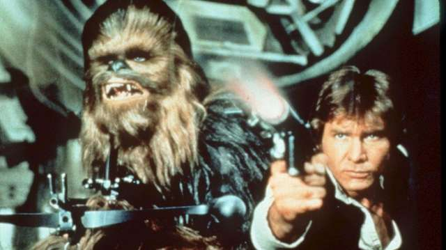 Chewbacca and Hans Solo (Harrison Ford) in the