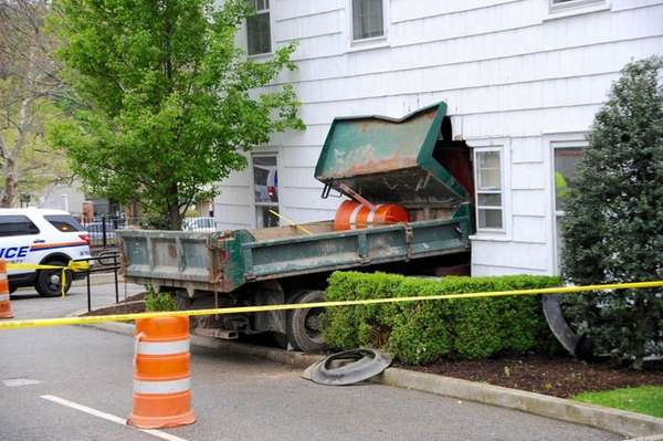 A construction dump truck plowed into a Roslyn