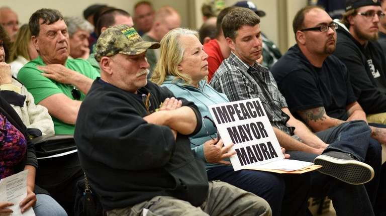 Mastic Beach residents attend a contentious public meeting,