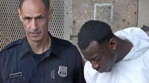 Duke Obule, 23, is escorted from Nassau