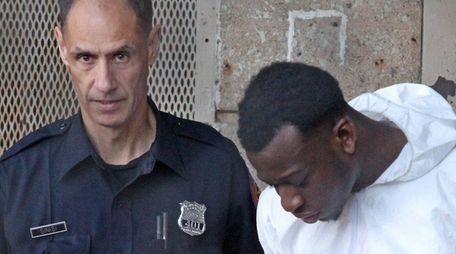 Duke Obule, 23, is escorted from Nassau