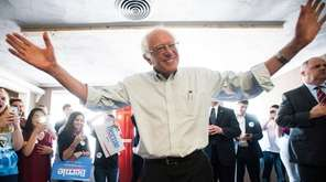 Democratic presidential candidate Bernie Sanders greets volunteers in