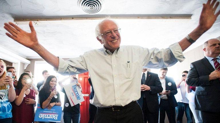Democratic presidential candidate Bernie Sanders greets volunteers in