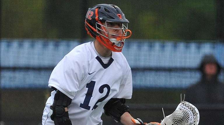 Matt Gavin #12 of Manhasset surveys the defense