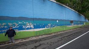 Artist-designer Sean Sullivan eyes an old, decaying mural