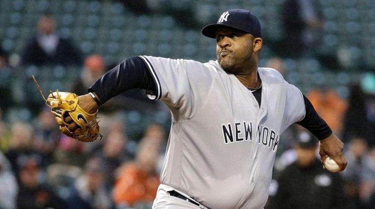 New York Yankees starting pitcher CC Sabathia throws