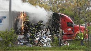 The Dix Hills Fire Department battles a tractor