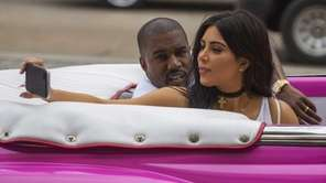 Kim Kardashian takes a selfie as she rides