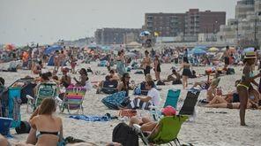 Beachgoers at Long Beach, Sunday, July 12, 2015.