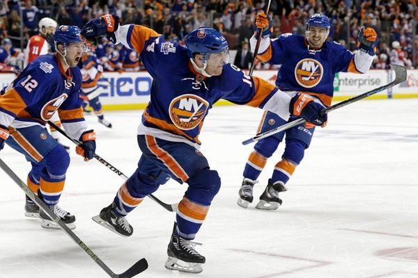 New York Islanders defenseman Thomas Hickey (14) celebrates