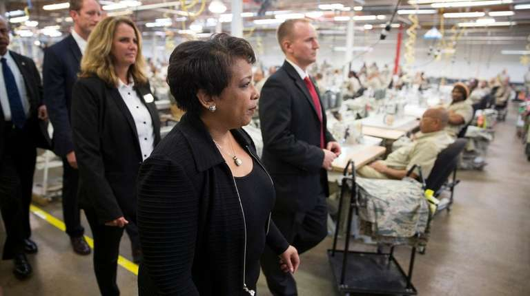Attorney General Loretta Lynch tours a factory where