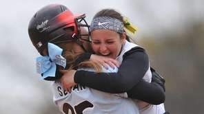 Lindenhurst's Stephanie Serwan, left, celebrates with teammate Alyssa