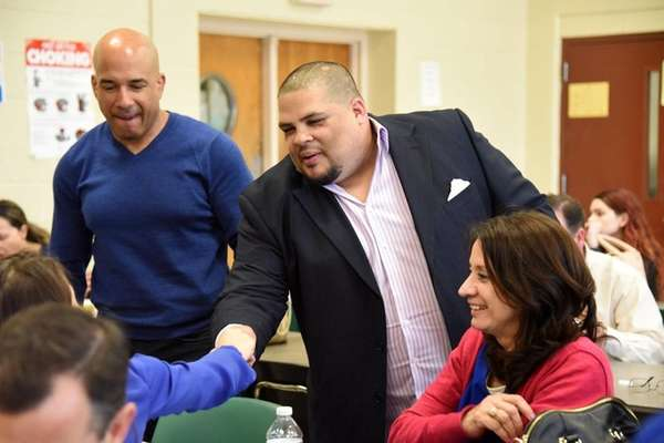 Matthew Maldonado, center, greets friends at a special