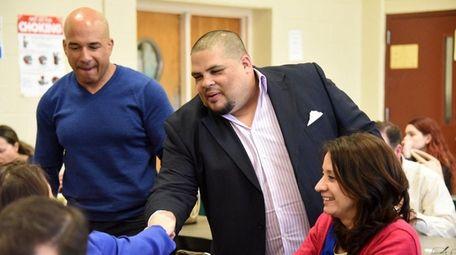 Matthew Maldonado, center, greets friends at a special