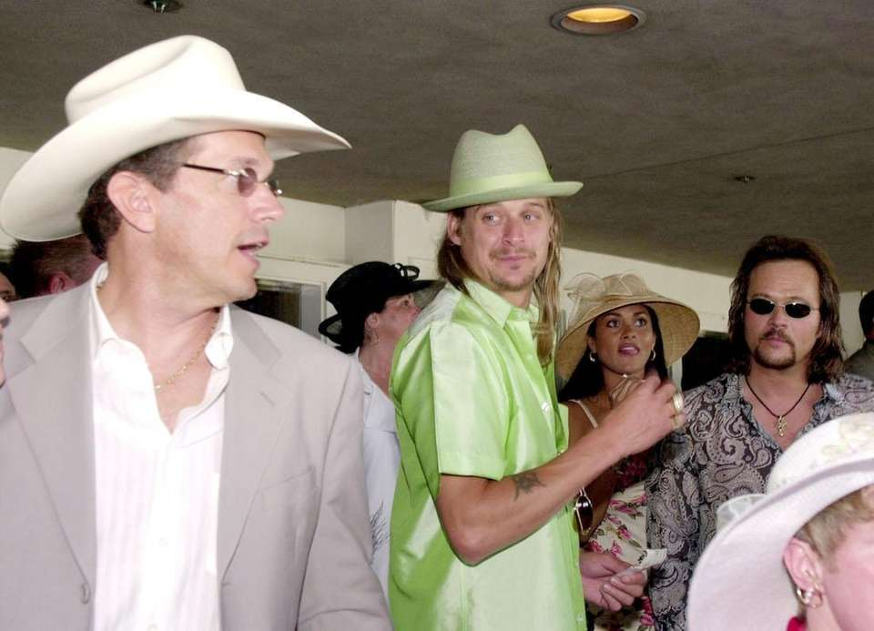 George Strait and Kid Rock during the 129th