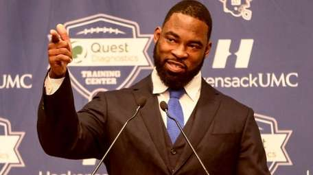 Justin Tuck addresses the media during his retirement