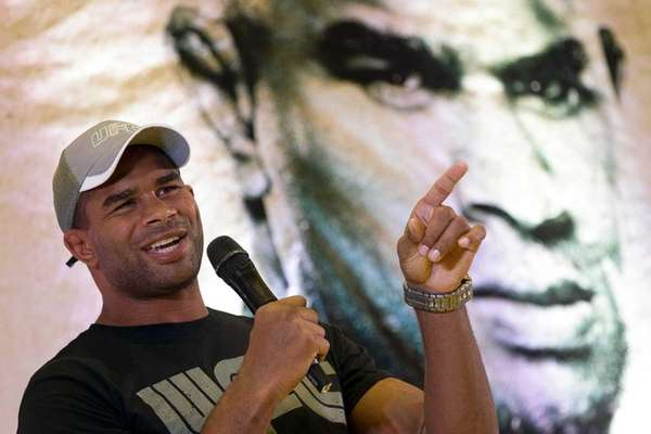 Alistair Overeem gestures during a UFC press conference