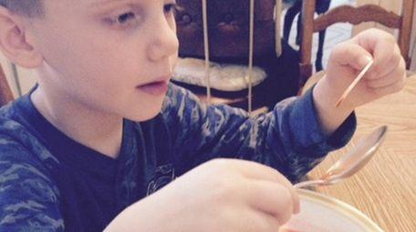 Opinions writer Patricia Schaefer's grandson, Kevin, enjoys ice-cream