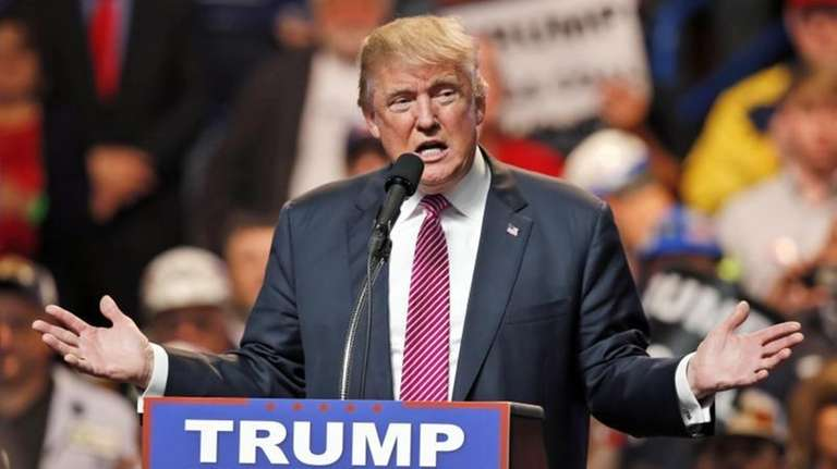 Republican presidential candidate Donald Trump gestures during a