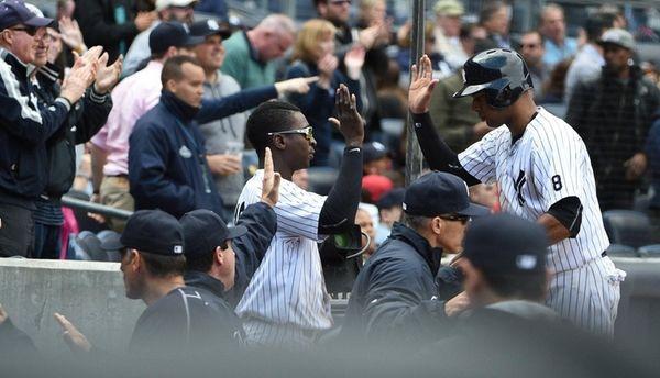 Yankees centerfielder Aaron Hicks is greeted in