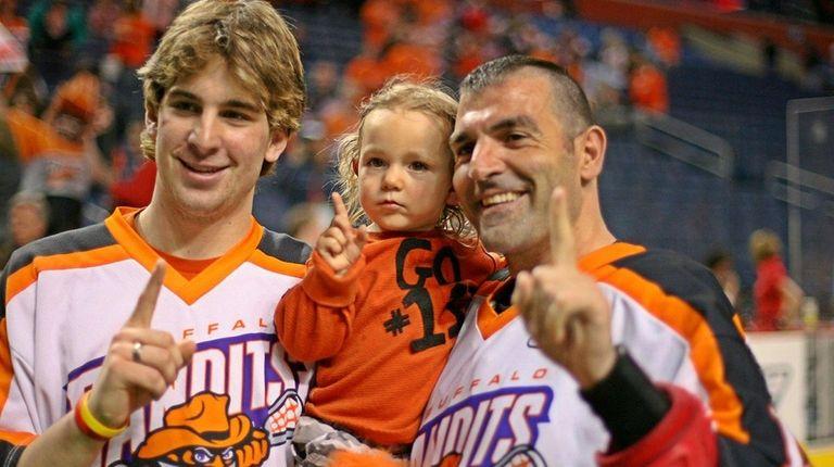 Future Islander John Tavares, left, with his uncle,