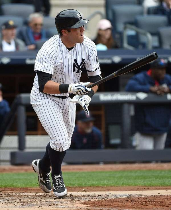 Yankees catcher Austin Romine swats an RBI