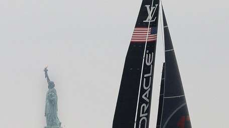 Oracle Team USA sails around the mouth of